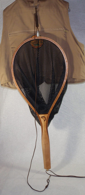 This is net 012 with magnetic net release attached and on a fishing vest