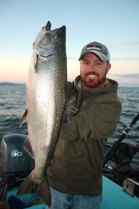 Dan Gravel of Owen Sound hoists a 12 lb Chinook caught on Sunday in Owen Sound Bay.  Gravel's salmon just missed the top ten daily leader board.  The fish was caught on a rotating flasher and fly combo trolled in 120 feet of water.