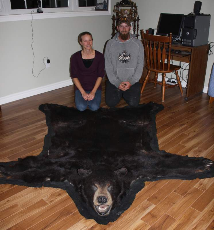 Clavering native Kim Barfoot and husband Chris show off the sheer size of the massive black bear she harvested in 2002.  The bear surpassed the 500lb mark and had a skull measurement of over 19 inches; a trophy bear anywhere in Canada.